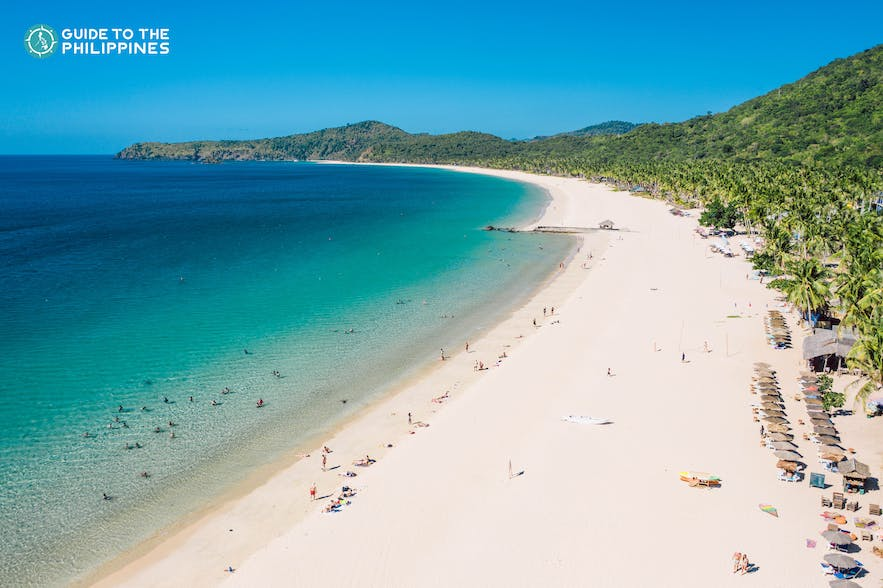 Drone shot of El Nido's Nacpan Beach stretch of white sand