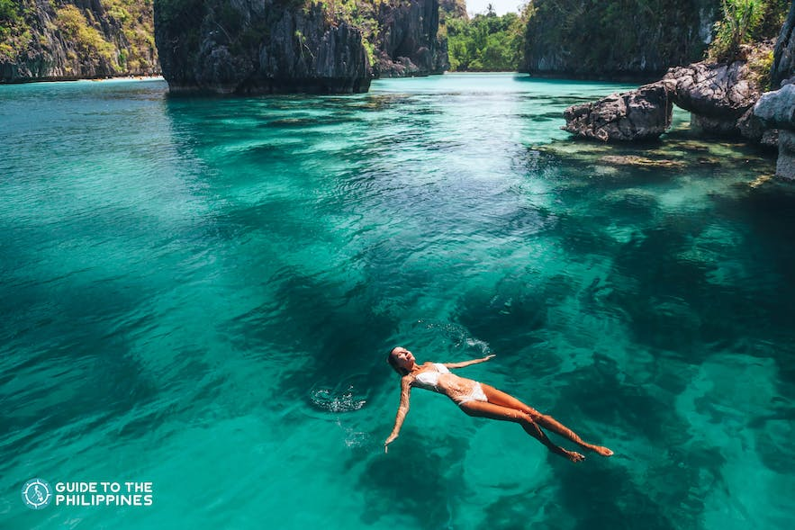 Traveler floating along a lagoon in El Nido, Palawan