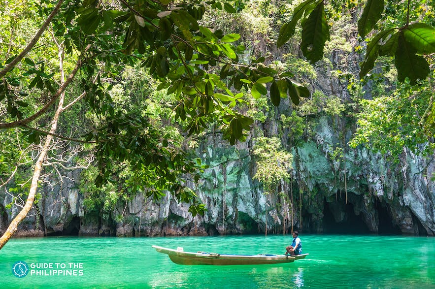 Boatman coming from the Underground River