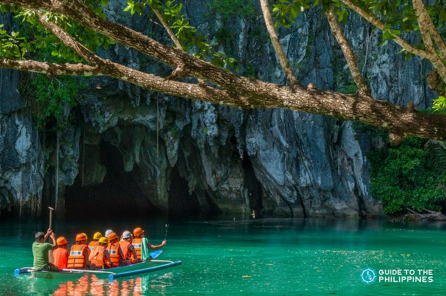 Travelers' boat going into the Underground River in Puerto Princesa, Palawan