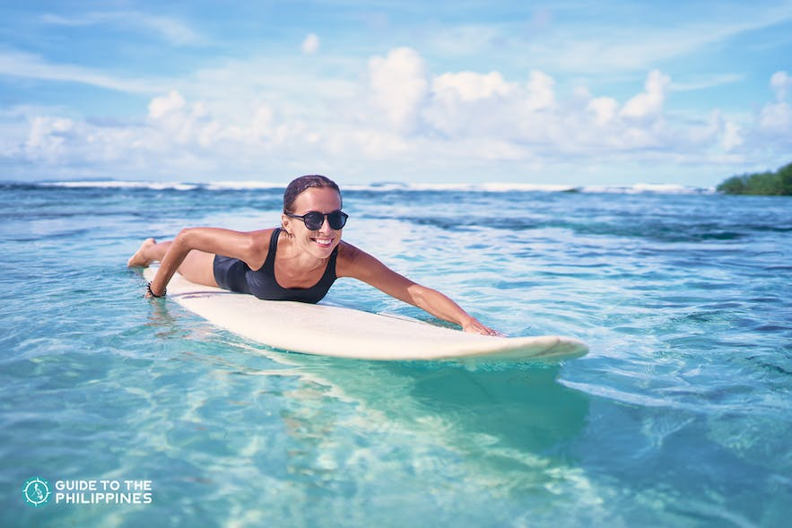 Surfer girl learning how to surf