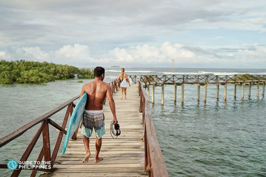 Surfers in Cloud 9 Boardwalk