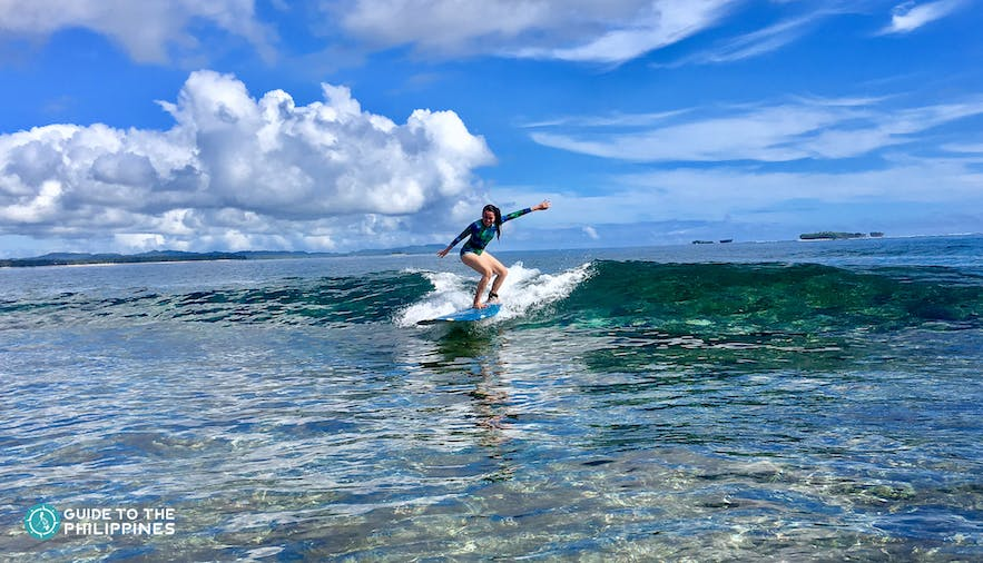 Girl surfer learning to surf