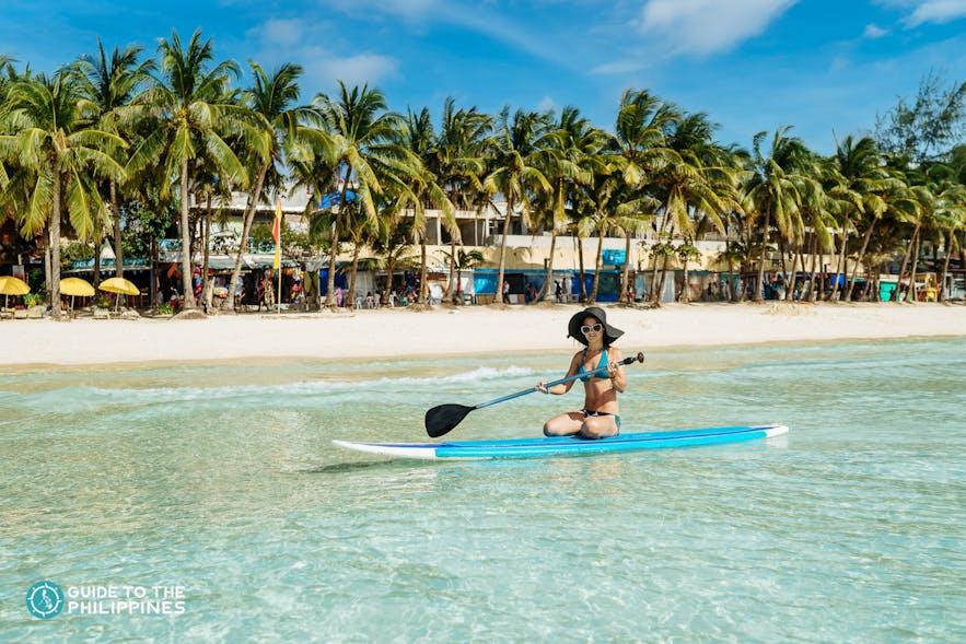Girl paddleboarding in Boracay