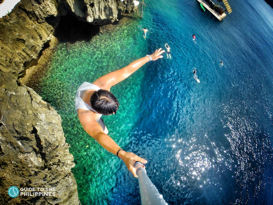 Man cliff-diving at Ariel's point