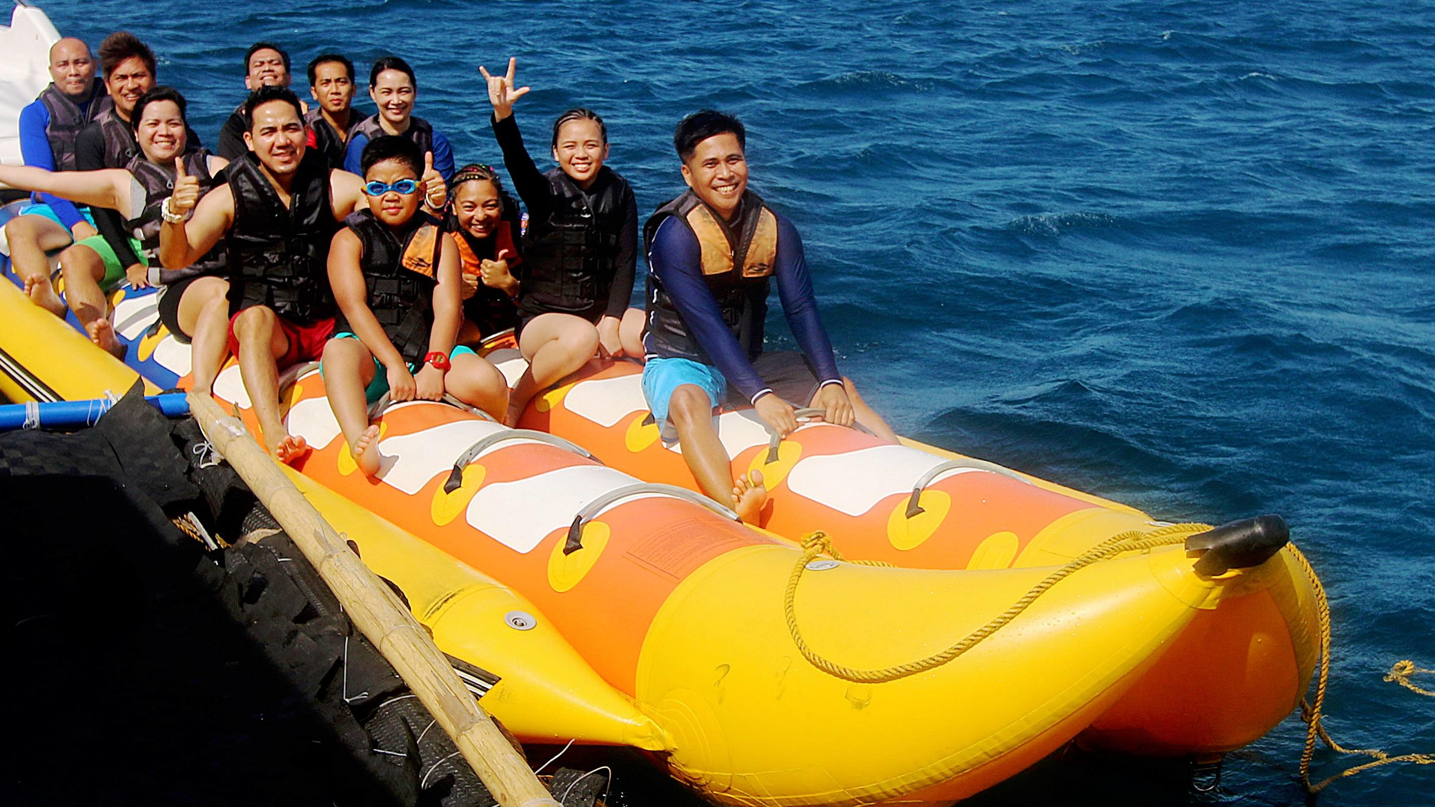 Family group enjoying banana boat ride at Boracay Beach