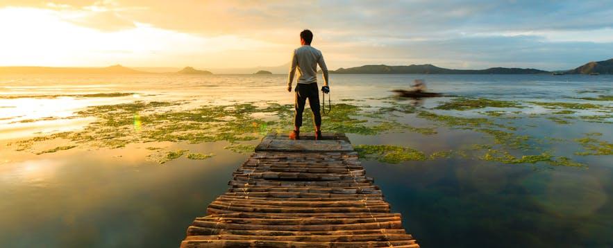 Man photographer looking at Taal Lake, Tagaytay