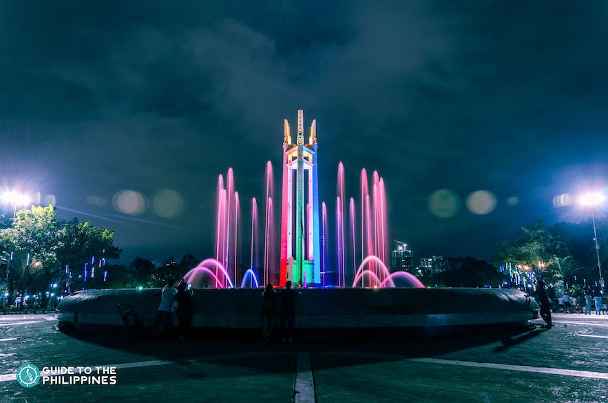 Dancing fountain and light show in Quezon City Memorial Circle at dusk