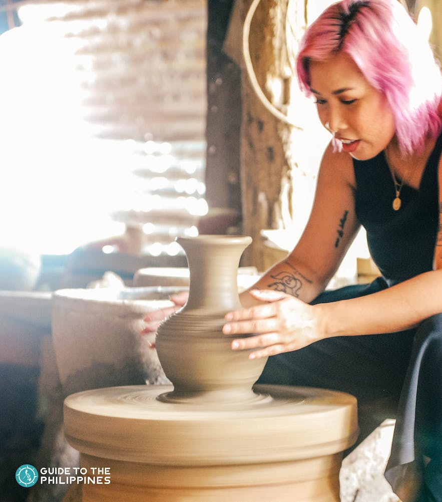 Traveler getting a hand at pottery making in RG Jar, Ilocos Sur