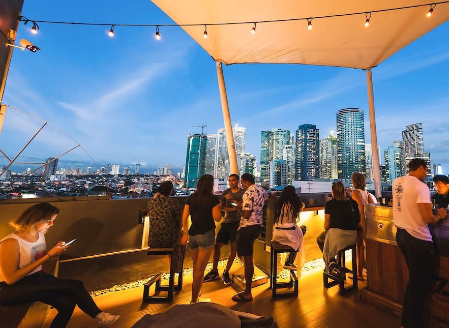 People having drinks at Z Hostel's rooftop bar in Poblacion, Makati