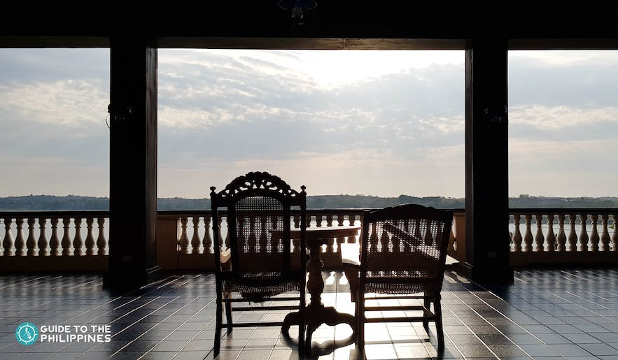Silhouette of a chair overlooking the mountains at the Malacañang of the North