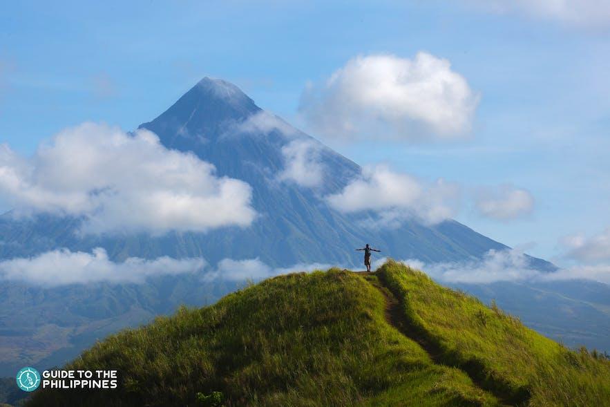 Hiker overlooking Mt. Mayon in Legazpi, Albay Philippines