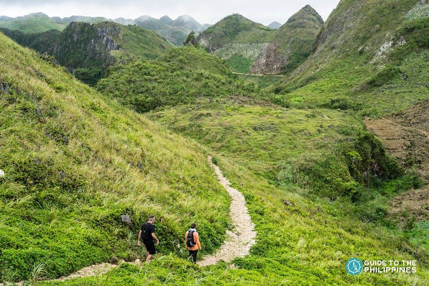 Hikers descending the Osmeña Peak in Dalaguete, Cebu, Philippines