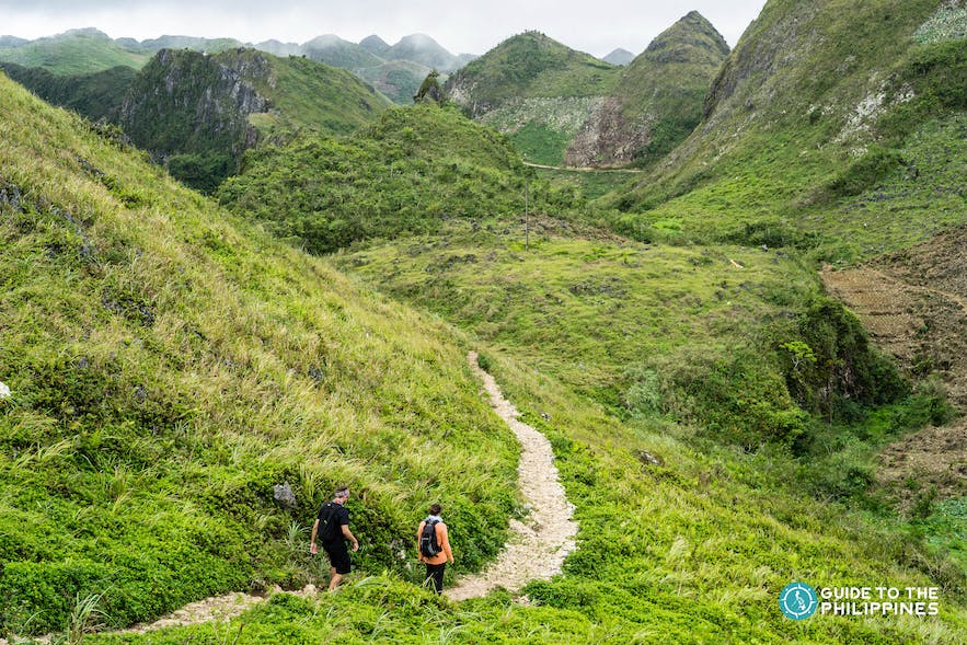 Hikers descending the Osmeña Peak in Dalaguete, Cebu, Philippines