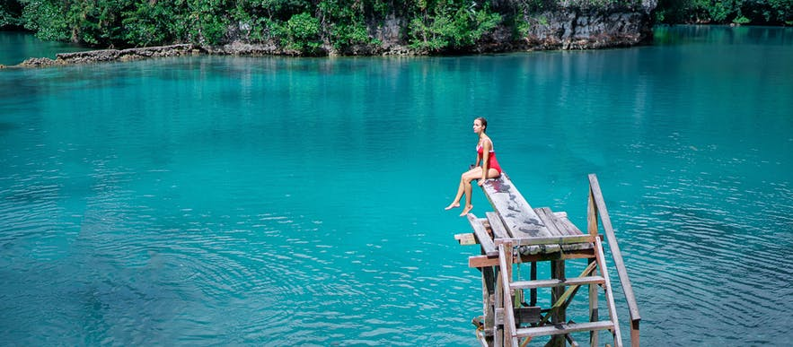 Woman traveler enjoying Sugba Lagoon in Siargao, Philippines