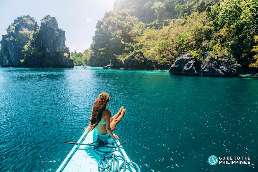 Woman traveler enjoying island hopping in El Nido, Palawan, Philippines