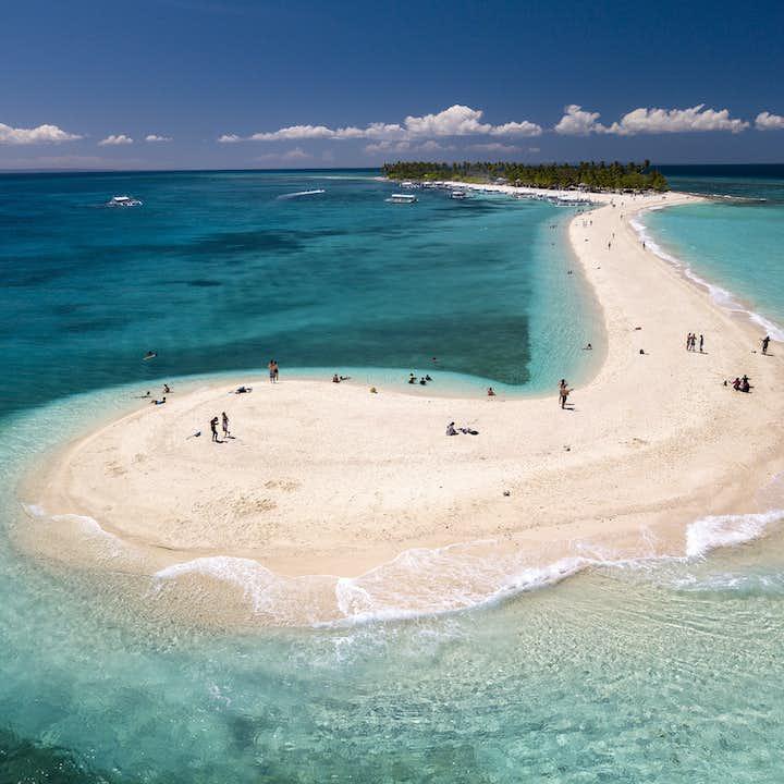 People relaxing on the sandbar of Kalanggaman Island