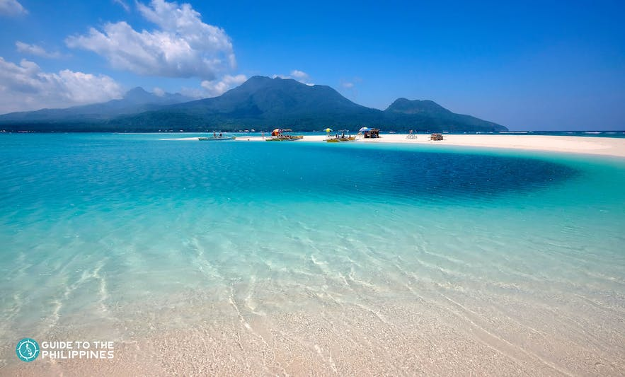Fine sand and clear blue waters in Camiguin Island
