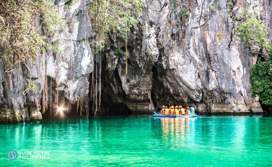 Travelers on a boat going into the Underground River in Puerto Princesa, Palawan