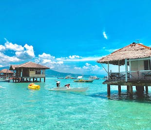 Manjuyod Sandbar, Dolphin Watching, & Souvenir Shopping Tour | With Transfers from Bacolod