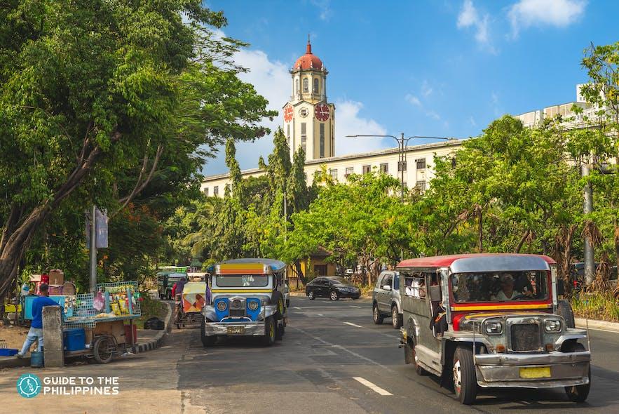 Philippine jeepneys passing by the Manila City Hall
