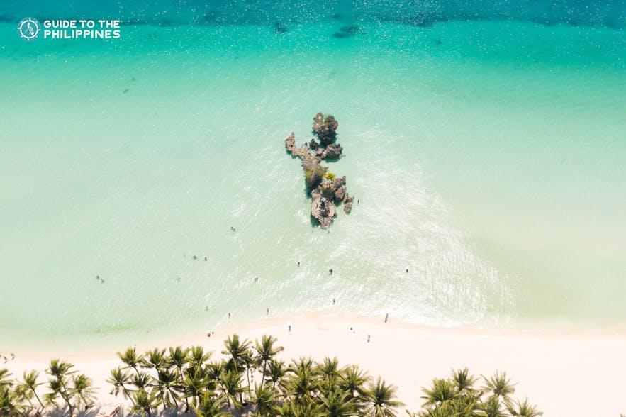 Stroll along the White Beach in Boracay, Aklan