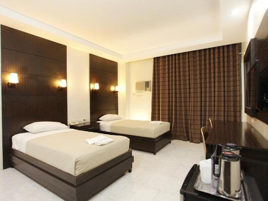 Guest room at Grand Astoria Hotel