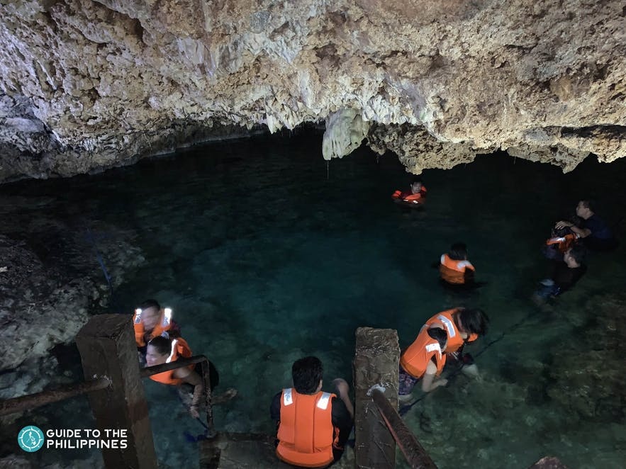 Travelers taking a dip at the Enchanted Cave in Pangasinan