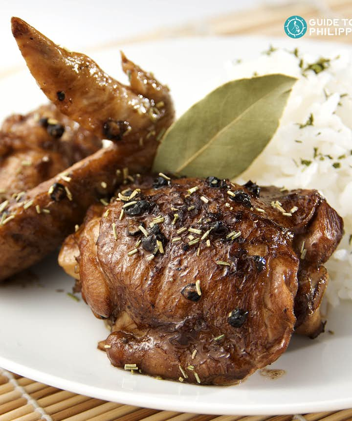 Iconic Chicken Adobo braised in vinegar, peppercorns, and bay leaves