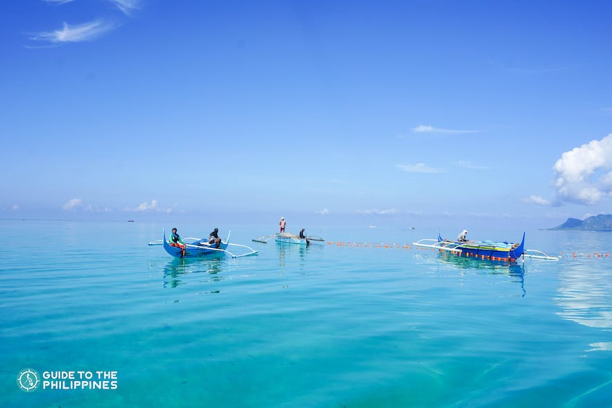 Boats by an island in Tawi-Tawi, Philippines