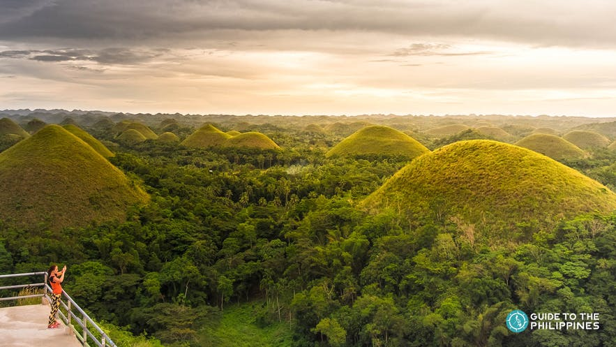 Traveler taking a photo from the Chocolate Hills Complex Viewpoint in Carmen, Bohol