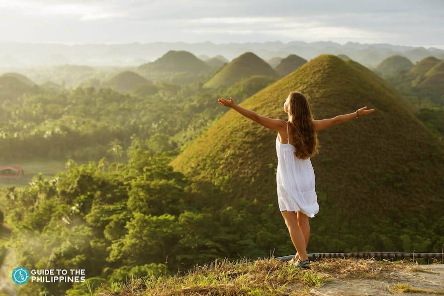 Traveler taking in the beauty of Chocolate Hills
