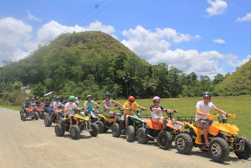 Group of travelers ready for their Chocolate Hills ATV adventure in Bohol, Philippines