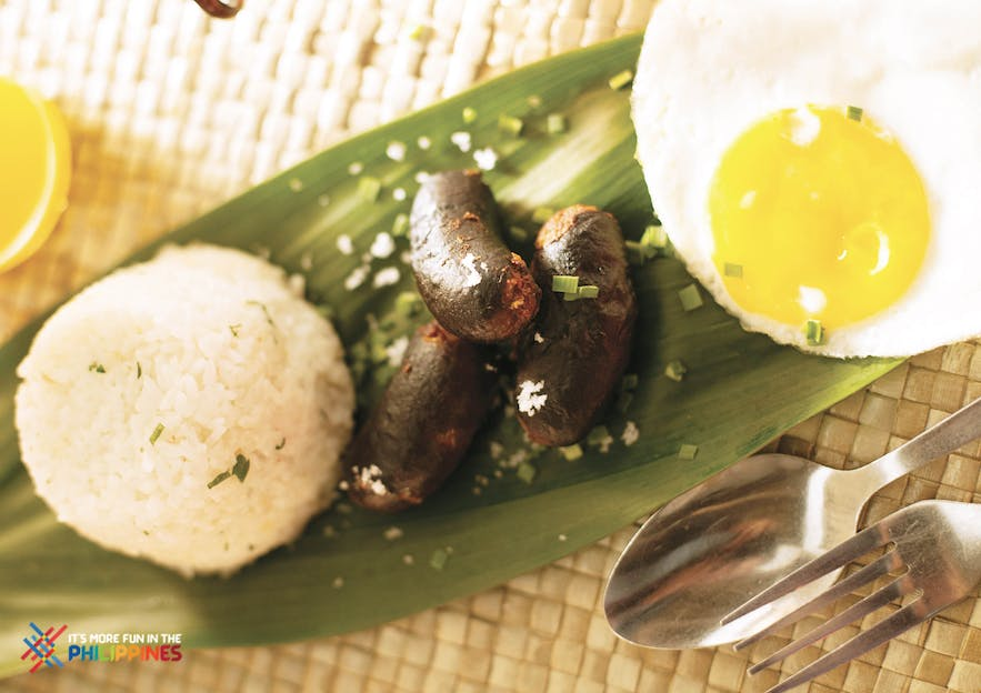 Longganisa with egg and fried rice for breakfast in the Philippines
