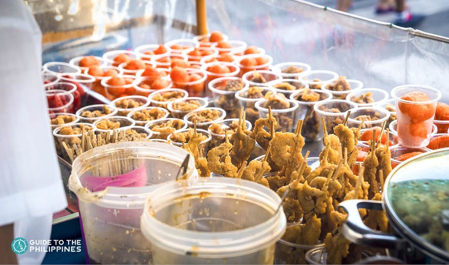 Fried isaw and kwek kwek are popular street food snacks in the Philippines