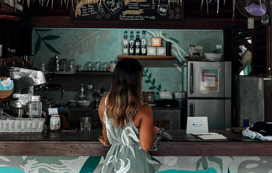 A woman waiting for her coffee in Filibeans in Siargao