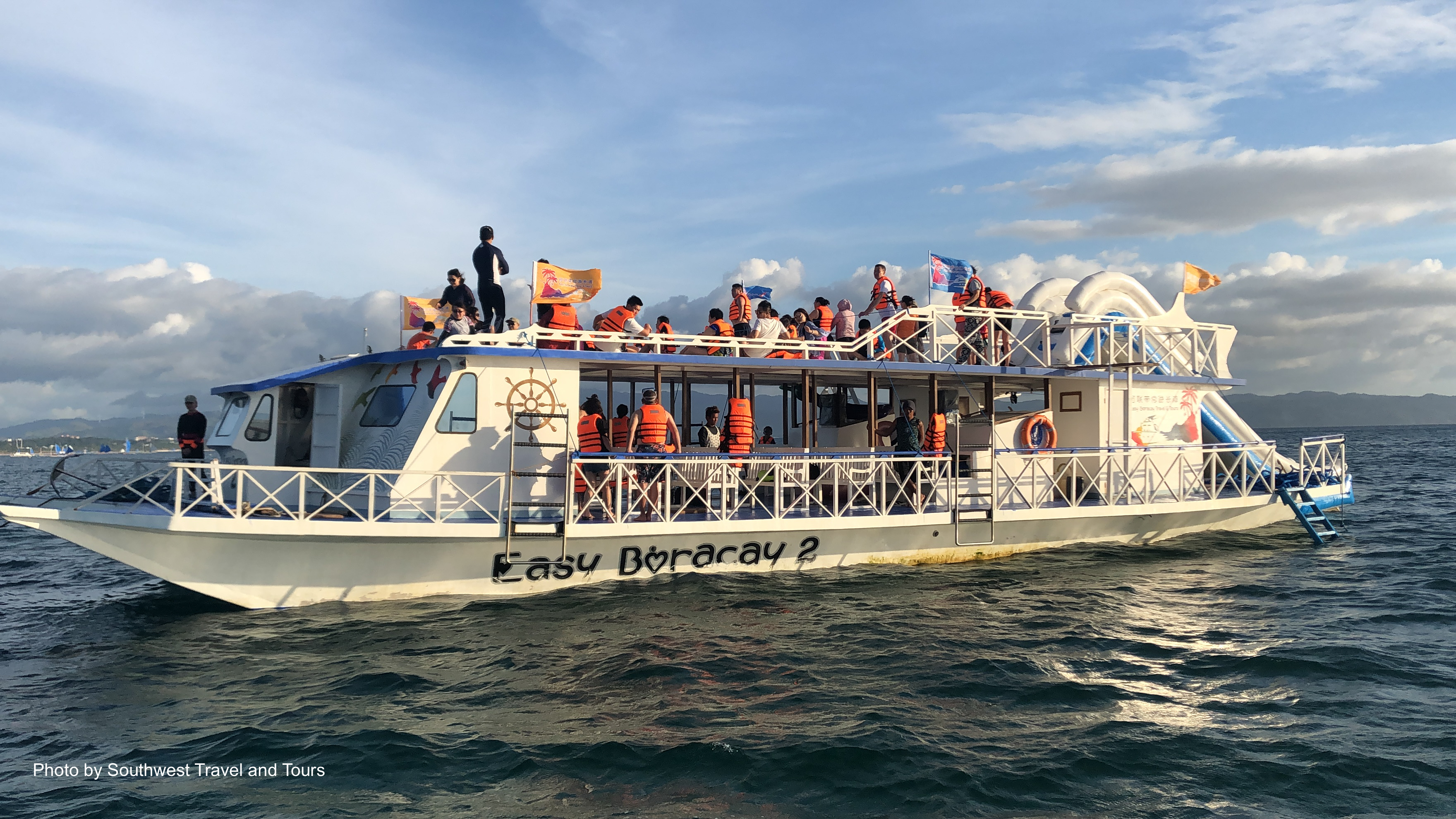 Cruisers onboard Boracay's party boat enjoying the fresh sea breeze and scenic views