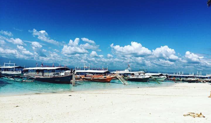Boats docked in Babusanta Beach in Talikud Island