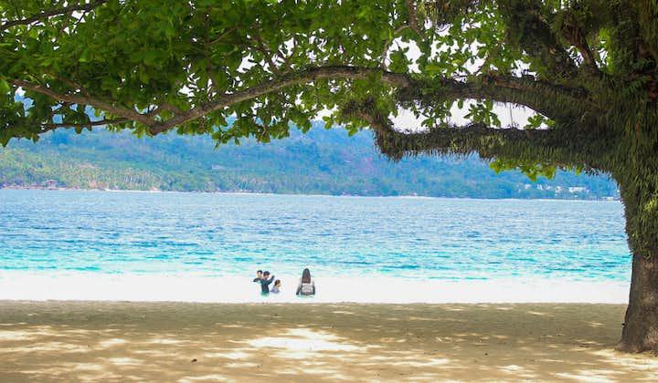 People swimming in a beach in Talikud Island