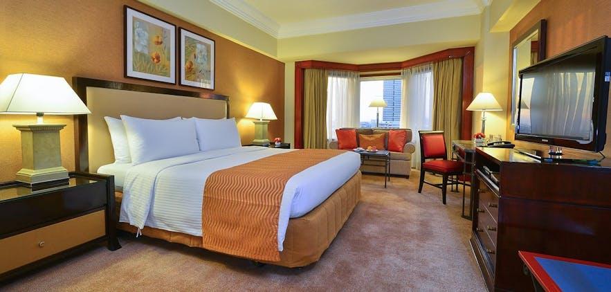 A bedroom of the 5-star Diamond Hotel Manila