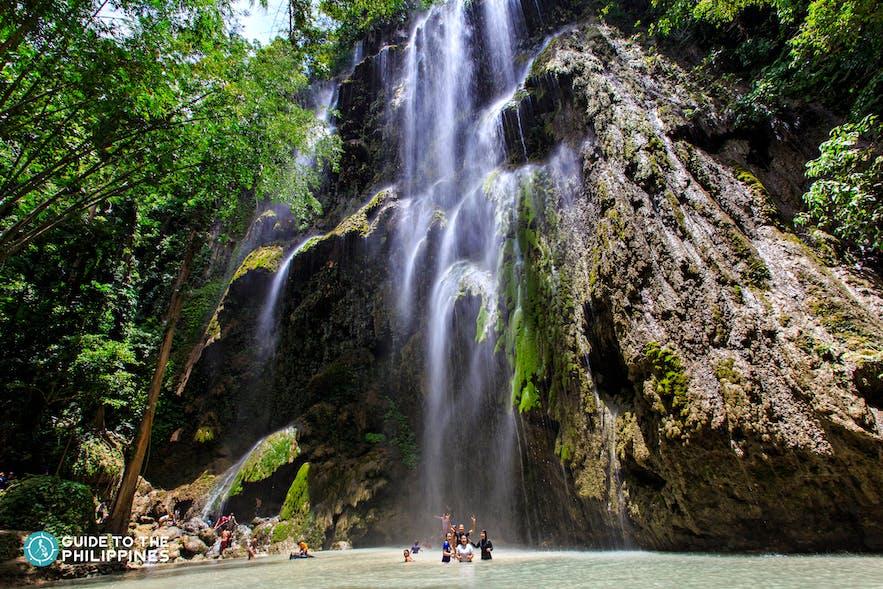 People enjoying Tumalog Falls in Oslob Cebu