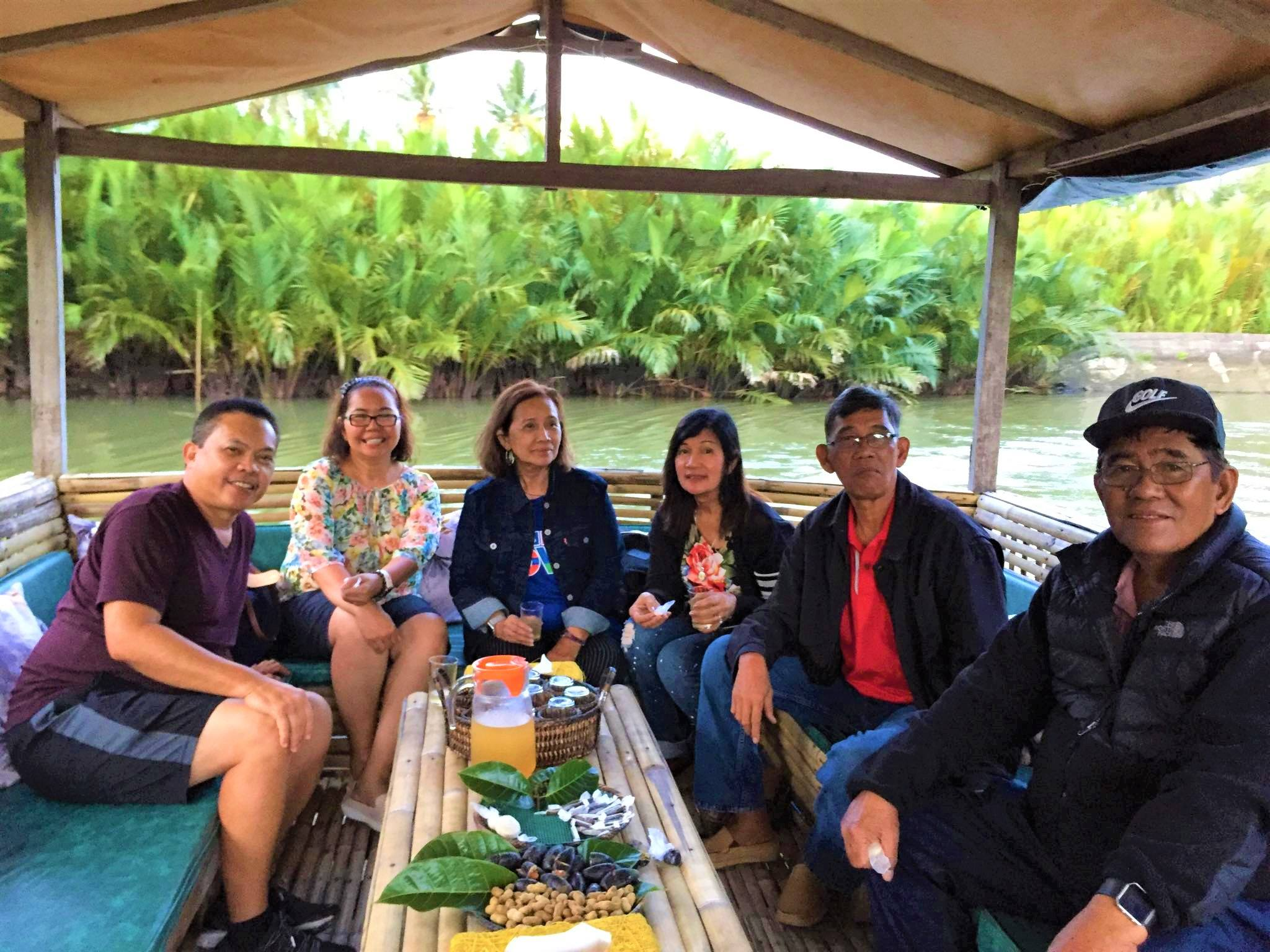 People enjoying the Buhatan River Cruise tour