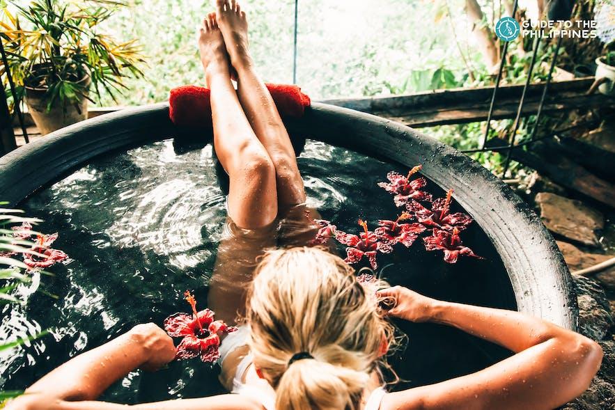 A woman enjoying the Kawa Hot Bath experience in Antique