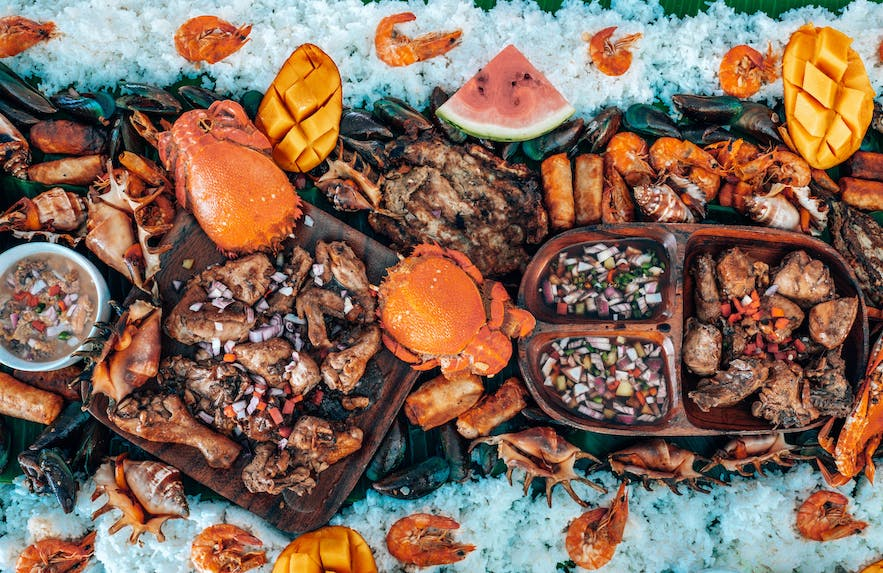 A boodle fight made from grilled meat and fresh seafood in the Philippines