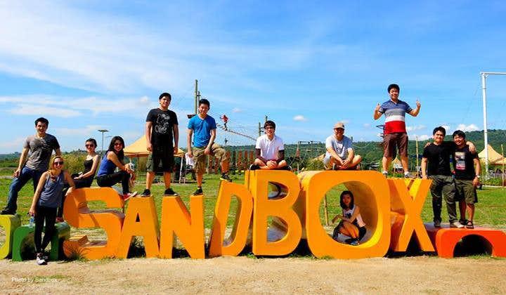 People posing at the Sandbox signage in Pampanga
