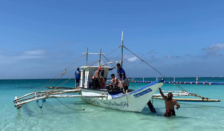 Divers riding a boat going to a dive spot in Boracay