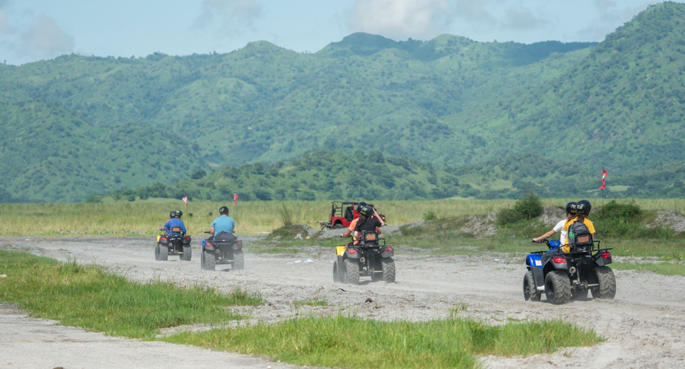 People riding the ATV in Mt. Pinatubo