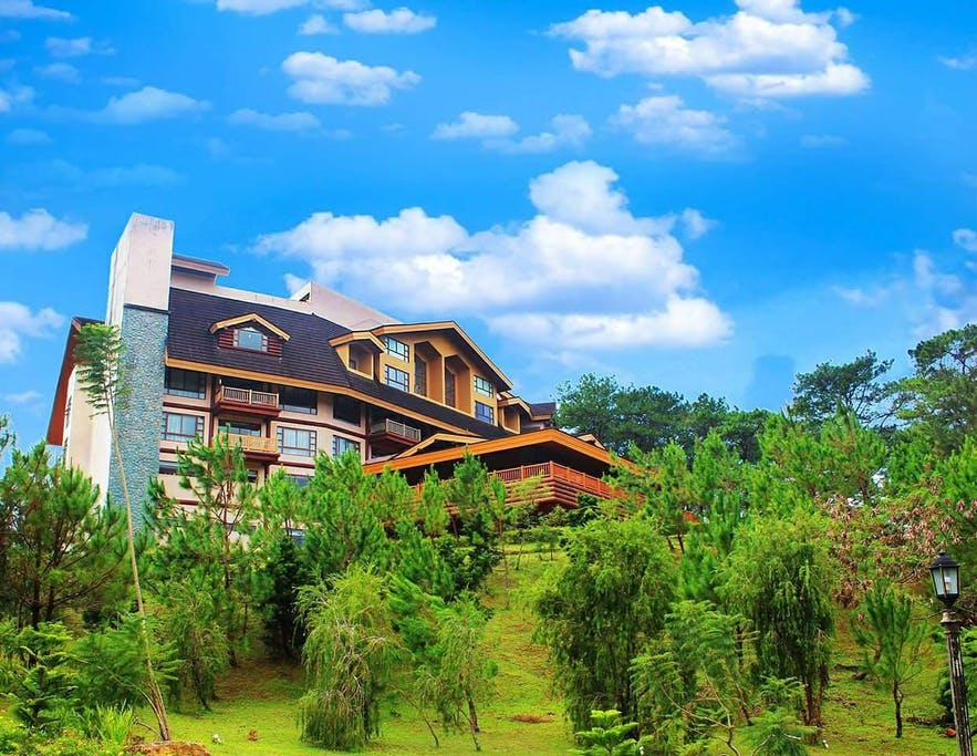 Green landscape surrounding The Forest Lodge at Camp John Hay