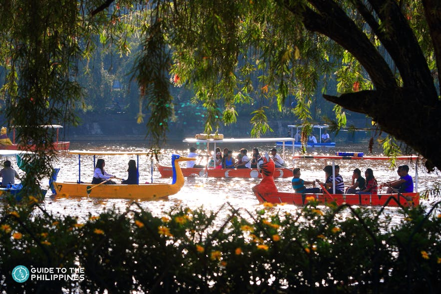 People riding the boats in Burnham Lake in Baguio