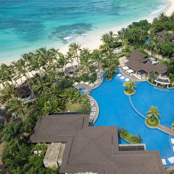 Aerial view of Movenpick Resort showing the huge swimming pools and access to the beach